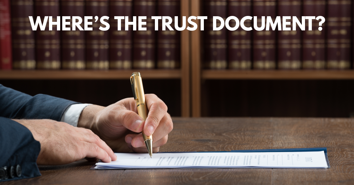 person writing on a trust document